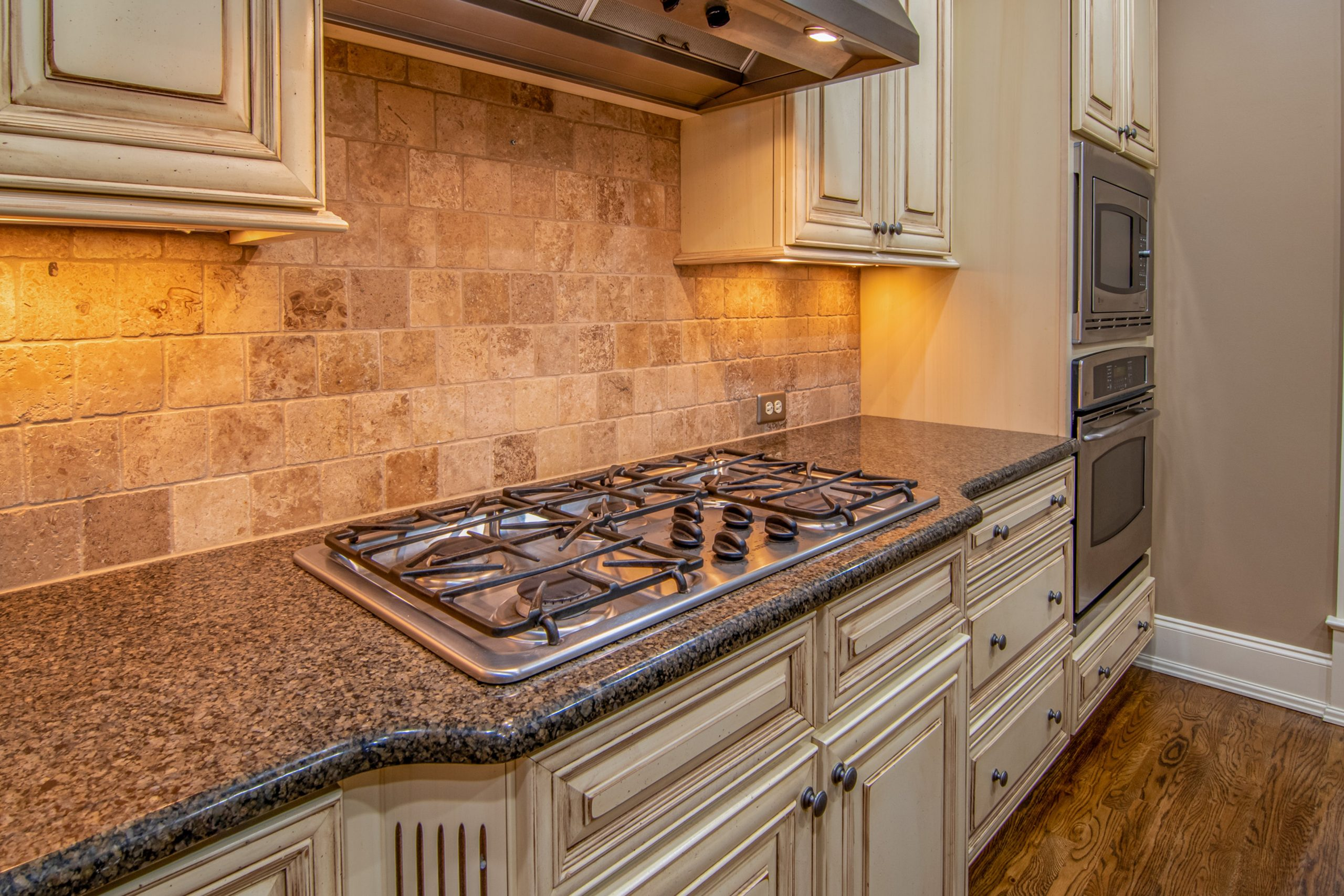 gas cooker wall mounted on granite countertop